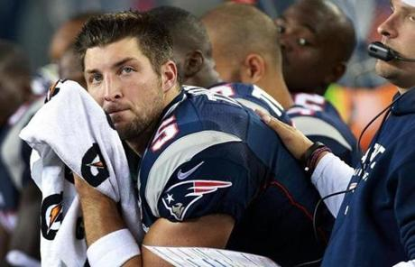 Tebow got a pat on the back from offensive coordinator Josh McDaniels after another three-and-out in the third quarter.