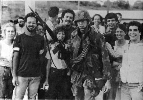 Asolider posed with students from the school after the invasion.