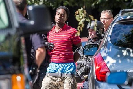 Police in Shadane Richards, 18, after the standoff. He faces four charges in the incident.