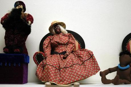 Ms. Ward Armstrong used cloth and buttons from far off places to create her soft sculpture dolls.