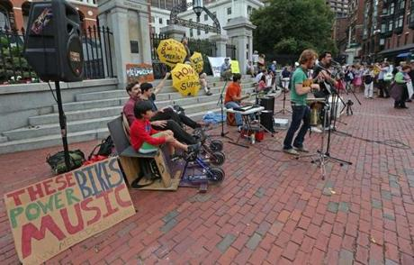 Activists rallied outside the State House Tuesday as lawmakers held a hearing on a bill that would divest the state pension fund from companies that are involved in fossil fuels, considered the main culprit in climate change.