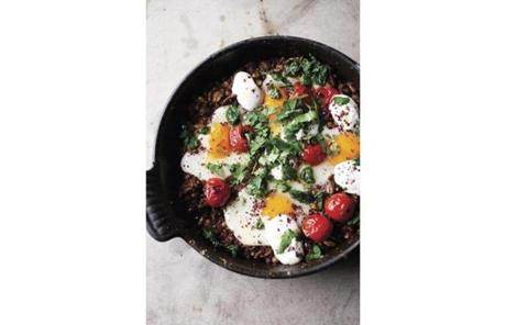 Braised eggs with lamb, tahini, and sumac, from the cover of