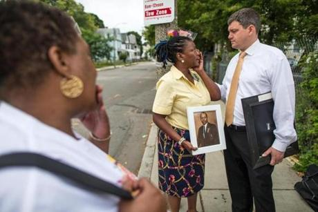 While campaigning recently, John Connolly spoke with Mary Franklin on Woodrow Avenue in Dorchester where her husband was killed in 1996.
