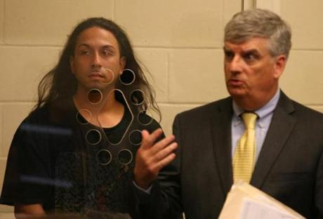 Carlos R. Velazquez (left) was arraigned on a murder charge in Brockton District Court.