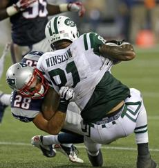 Patriots safety Steve Gregory wrapped up Jets tight end Kellen Winslow in the second quarter.