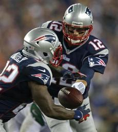 Brady handed off to running back Stevan Ridley in the first half.
