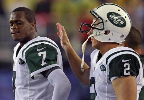 Jets quarterback Geno Smith was consoled by kicker Nick Folk along the sidelines after he turned the ball over on a key interception pass late in the fourth quarter.