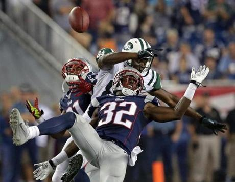 Patriots defensive back Devin McCourty and cornerback Aqib Talib broke up a pass intended for the Jets' Stephen Hill.