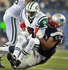 Jets quarterback Geno Smith was sacked by the Patriots' Tommy Kelly in the third quarter.