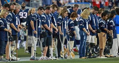 Victims of the Marathon bombings who lost limbs were honored on the field before the game, and a moment of silence was held for those who died in the attacks.