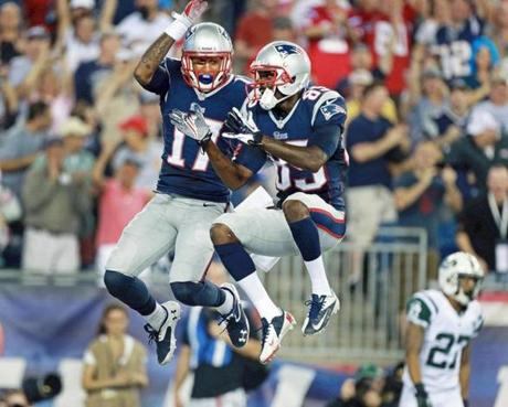 Dobson (left) celebrated with fellow wide receiver Kenbrell Thompkins. Dobson's touchdown put the Patriots ahead, 7-0.