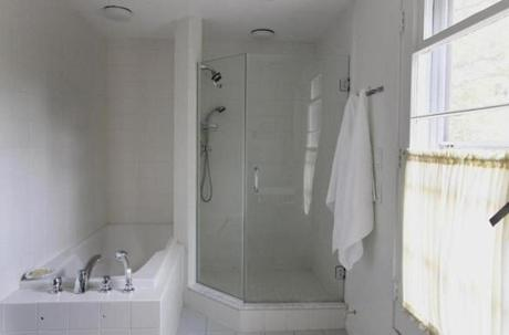 The second-floor master has a private bath with soaking tub and separate shower.