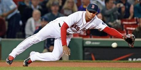 Xander Bogaerts dove to his left, but couldn't come up with a single by the Orioles Manny Machado in the first inning.