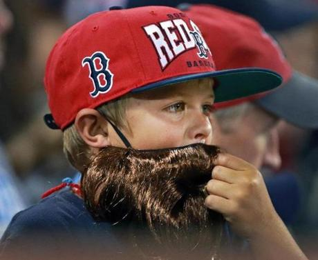 A young fan sported a fake beard in tribute to the bearded Boston ballplayers.