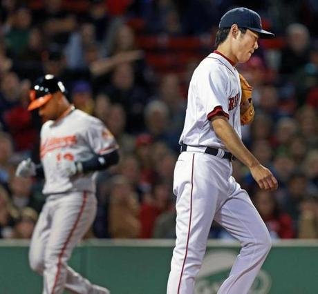 Koji Uehara was downcast as pinch runner Alexi Casilla scored on a sacrifice fly to give the Orioles the lead.