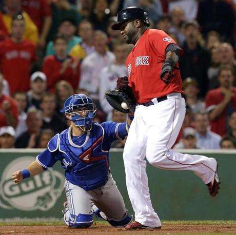 David Ortiz was tagged out by Blue Jays catcher J.P. Arencibia while trying to score.