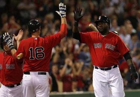 Nava and Ortiz got high-fives from Middlebrooks after scoring on a seventh inning single by Carp (not pictured).