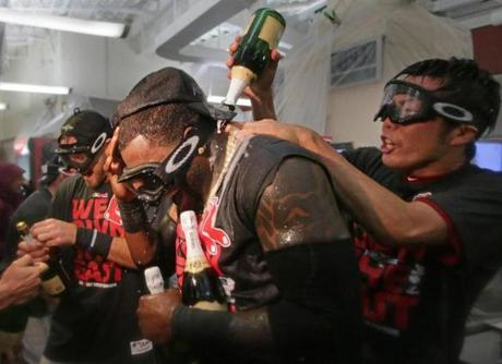 Uehara christened Ortiz with celebratory champagne in the clubhouse.