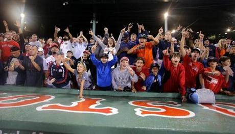 Fans cheered after the Red Sox clinched the AL East title, their first division title since 2007.