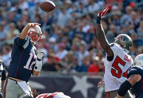 Brady threw a pass over the rush of Lavonte David for a first down to Dobson (not pictured) in the third quarter.