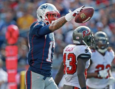 Dobson caught Brady's pass for a first down.