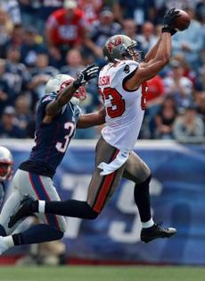 Vincent Jackson hauled in a pass in front of Alfonzo Dennard in the first quarter.