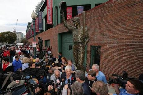 Reporters surrounded Carl Yastrzemski at the unveiling of his statue Sunday.