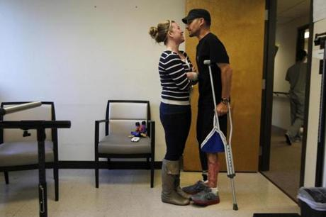 Marc and Jen shared a moment after he walked down the hall and back with his new prosthetic leg at the Hanger Clinic in Woburn.