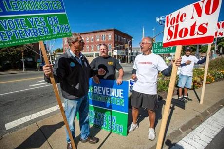 Residents vote Tuesday on David Cordish's $200 million project, which, if approved, will compete for the state's only slots license. At left, Rick LaBonte and Rich Brow, who favor the project, and casino opponent Joe Tammaro  held signs in downtown Leominster Saturday to try to sway voters.