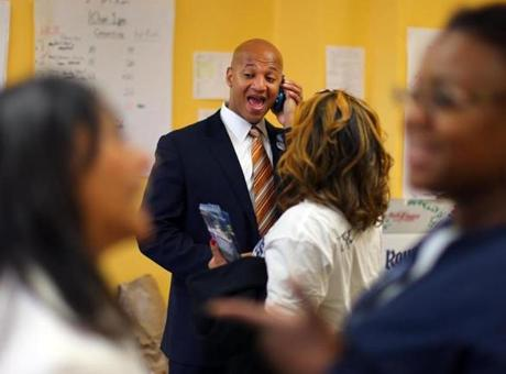 John Barros answered his phone as he visited his campaign workers at the Mattapan campaign office.