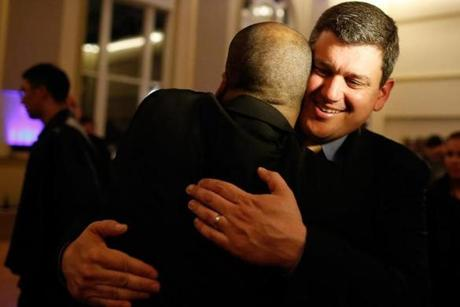 John Connolly was congratulated by a supporter Tuesday night at his victory party.