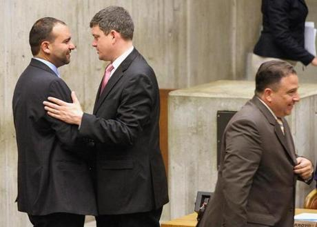 John R. Connolly (center), Felix G. Arroyo, and Rob Consalvo before a City Council meeting Wednesday.