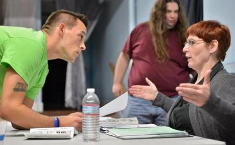 Actor Jason Hair-Wynn discusses a scene with director Jeanne Callinan.