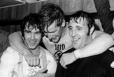 On May 10, 1970, the Bruins won their first championship since 1941; players (from left) Derek Sanderson, Bobby Orr, and Phil Esposito celebrate, grin, and drip.