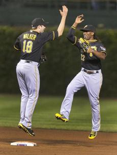 Pirates second baseman Neil Walker and center fielder Andrew McCutchen celebrated an 8-2 victory over the Cubs at Wrigley Field.