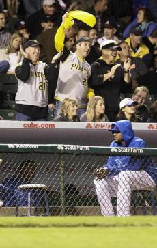 Pirates fans behind the Cub dugout during an 8-2 win.