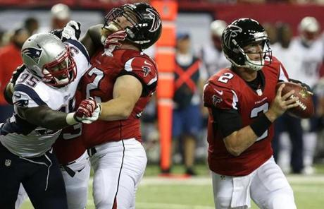 Patriots defensive end Chandler Jones worked against Atlanta Falcons tackle Sam Baker as he fought to get to Atlanta Falcons quarterback Matt Ryan .