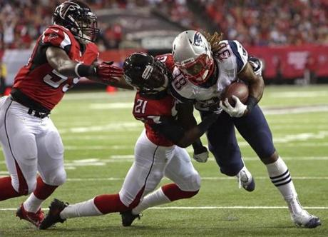 In the second quarter, Patriots running back Brandon Bolden broke several tackles as he fought for the end zone.