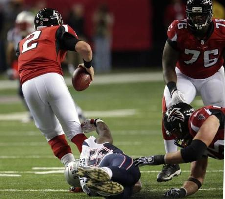 Patriots defensive end Chandler Jones was down but was still able to trip up Atlanta Falcons quarterback Matt Ryan in the fourth quarter.