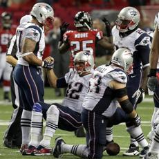 Brady  is helped up after a fumbled snap with the Patriots at 4th and 1 yard needed.