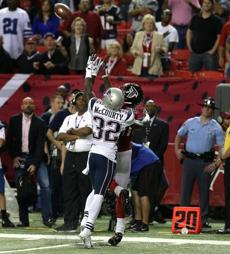 Atlanta wide receiver Julio Jones pulled in a 49 yard pass with New England free safety Devin McCourty defending.