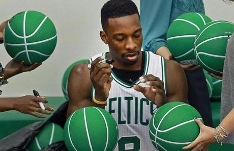 Jeff Green was surrounded by green basketballs to sign.