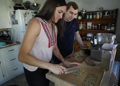 "88 ACRES: Nicole Ledoux and her husband, Rob Dalton, in their Allston kitchen working on healthy snacks for their company, 88 acres, that is using Kickstarter to enlist early adopters who they hope will be ""brand evangelists."""