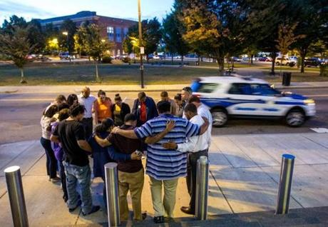Family and friends prayed outside the Boston Police District B-2 Headquarters in Roxbury Thursday.