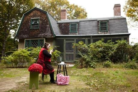 Beth Randall, production manager for Theater in the Open in Newburyport, put on her makeup outside the company's house.