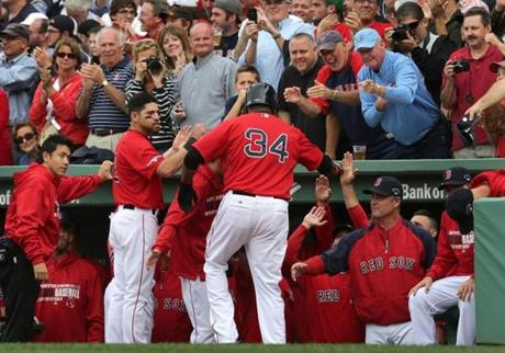Designated hitter David Ortiz was congratulated in the dugout after scoring.