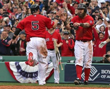 Left fielder Jonny Gomes (left) was congratulated at home plate after scoring on an RBI double by catcher Jarrod Saltalamacchia (not pictured) in the fifth inning.
