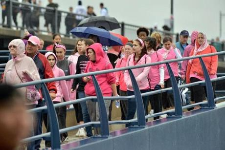 Several walkers held umbrellas as the rain fell in Boston.