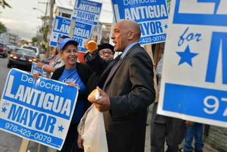 Mayor William Lantigua gave out stickers to supporters at a busy intersection.