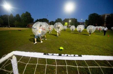 A player took a long shot on goal. There are no red cards, yellow cards, and no goalies in bubble soccer.